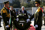 Palestinian President Mahmoud Abbas lays a wreath on the grave of late Palestinian leader Yasser Arafat on the first day of Eid al-Adha, or feast of the sacrifice, in the West Bank city of Ramallah, on Sep. 12, 2016. Muslims around the world are celebrating Eid al-Adha, the Festival of Sacrifice, to mark the end of the hajj pilgrimage by slaughtering sheep, goats, cows and camels to commemorate Prophet Abraham's readiness to sacrifice his son Ismail on God's command. Photo by Shadi Hatem