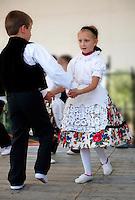 traditional children dancers in local german Svab traditional  dress - Annual wine harvest festival ( szuret fesztival ) . Hajos ( Hajós); Hungary