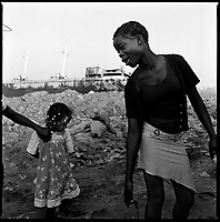 Luanda, Angola, May, 20, 2006.Porto do Pesqueiros, open air sewer; Gilda, 14, right, playing in garbage and cholera infected waters. Between February and June 2006, more than 30000 people were infected with cholera in Angola's worse outbreak ever; more than 1300 died.