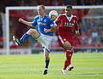 Aberdeen v St Johnstone...31.08.13      SPFL<br /> Steven Anderson and Josh Magennis<br /> Picture by Graeme Hart.<br /> Copyright Perthshire Picture Agency<br /> Tel: 01738 623350  Mobile: 07990 594431