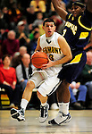 13 December 2009: University of Vermont Catamounts' guard Joey Accaoui, a Junior from Lincoln, RI, in action against the Quinnipiac University Bobcats at Patrick Gymnasium in Burlington, Vermont. The Catamounts defeated the visiting Bobcats 80-77 to mark the Cats' season home opener with a win. Mandatory Credit: Ed Wolfstein Photo