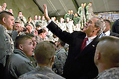 Bagram Air Field, Afghanistan - December 15, 2008 -- United States President George W. Bush waves to military members at Bagram Air Field, Afghanistan, Monday, December 15, 2008. After giving his speech, he took time to shake hands and individually thank troops for their service. .Credit: Samuel Morse - U.S. Air Force via CNP