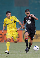 WASHINGTON, DC - AUGUST 4, 2012:  Branko Boskovic (8) of DC United keeps the ball from Milovan Mirosevic (10) of the Columbus Crew during an MLS match at RFK Stadium in Washington DC on August 4. United won 1-0.