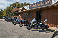 This place is part of the biker experience as a favorte stop on their route through the hill country.  Bikes outside of Reverend Jims Dam Pub near Lake Buccanna in the Texas Hill Country.  The parking in front is reserved for bikes only.