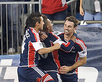 New England Revolution midfielder Andy Dorman (12) celebrates his goal with teammates.  In the first game of two-game aggregate total goals Major League Soccer (MLS) Eastern Conference Semifinal series, New England Revolution (dark blue) vs Sporting Kansas City (light blue), 2-1, at Gillette Stadium on November 2, 2013.