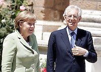 Il Presidente del Consiglio Mario Monti, a destra, accoglie il Cancelliere tedesco Angela Merkel in occasione del Vertice Quadrilaterale fra Italia, Spagna, Francia e Germania, a Villa Madama, Roma, 22 giugno 2012..Italian Premier Mario Monti, right, welcomes German Chancellor Angela Merkel as she arrives for the Quadrilateral Summit among Italy, Spain, France and Germany, at Villa Madama, Rome, 22 june 2012..UPDATE IMAGES PRESS/Riccardo De Luca
