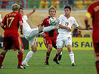 The United States' Jared Jeffrey (8), left, reaches to take control of the ball against Germany's Lewis Holtby (10) and with help from American Jorge Flores (19)  during the FIFA Under 20 World Cup Group C Match between the United States and Germany at the Mubarak Stadium on September 26, 2009 in Suez, Egypt.