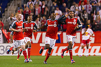 Ryan Johnson (9) of Toronto FC celebrates scoring during the first half against the New York Red Bulls during a Major League Soccer (MLS) match at Red Bull Arena in Harrison, NJ, on September 29, 2012.