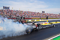 May 17, 2015; Commerce, GA, USA; NHRA top fuel driver Dave Connolly (near lane) burns out alongside Terry McMillen during the Southern Nationals at Atlanta Dragway. Mandatory Credit: Mark J. Rebilas-USA TODAY Sports