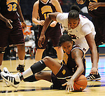 "Central Michigan's Crystal Bradford, bottom, and Mississippi's Nikki Byrd go for a loose ball at C.M. ""Tad"" Smith Coliseum in Oxford, Miss. on Wednesday, December 14, 2011. (AP Photo/Oxford Eagle, Bruce Newman)"