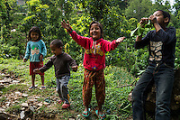 Monika (7, in red) and Aastha Baniya (6, in blue) play with their cousins in front of their temporary home in Chautara, Sindhupalchowk, Nepal on 29 June 2015. The three girls lost their mother during the April 25th earthquake that completely levelled their house. Aastha was buried under the rubble together with her mother but Aastha survived. As their father Ratna Baniya (28) cannot care for the children on his own, SOS Childrens Villages has since been supporting the grandmother with financial and social support so that she can manage to raise the children comfortably and ensure that they will all be schooled. Photo by Suzanne Lee for SOS Children's Villages