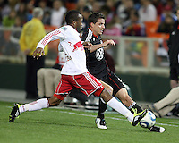 Mark Burch (4) of D.C. United  with Dane Richards (19) of the New York Red Bulls during an MLS match at RFK Stadium, in Washington D.C. on April 21 2011. Red Bulls won 4-0.