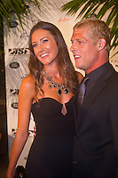 """GOLD COAST, Queensland/Australia (Thursday, February 24, 2011) Mick Fanning (AUS) and his wife Karrisa.   -The ASP World Surfing Awards was held  tonight at the Gold Coast Convention and Exhibition Centre. .Surfing's """"night of nights"""", the ASP World Surfing Awards, was a gala event, hosting the world's best surfers as well as distinguished figures from the surfing industry to honor of the 2010 ASP World Champions.. .Kelly Slater (USA), 39,  accepted his history-making and unprecedented tenth ASP World Title just a day before opening his 2011 ASP World Title campaign at the Quiksilver Pro Gold Coast.  .Stephanie Gilmore (AUS), 23,  made her own history ton the  evening, collecting her fourth consecutive Women's World Title. Gilmore will begin her 2011 assault this weekend at the opening event of the 2011 ASP Women's World Title season, the Roxy Pro Gold Coast.. .Slater and Gilmore headlined a slew of incredible athletes on the evening.. .Awards Recipient List:. .2010 ASP World Champion:Kelly Slater (USA).2010 ASP Women's World Champion:Stephanie Gilmore (AUS). .2010 ASP World Tour Runner-Up:Jordy Smith (ZAF).2010 ASP Women's World Tour Runner-Up:Sally Fitzgibbons (AUS). .2010 ASP World Tour Rookie of the Year: Owen Wright (AUS).2010 ASP Women's World Tour Rookie of the Year:Carissa Moore (HAW. .2010 ASP World Tour 'Breakthrough Performer':TBA.2010 ASP Women's World Tour 'Breakthrough Performer':TBA. .2010 ASP World Longboard Champion:Duane DeSoto (HAW).2010 ASP Women's World Longboard Champion:Cori Schumacher (HAW). .2010 ASP World Junior Champion:Jack Freestone (AUS).2010 ASP Women's World Junior Champion:Alizee Arnaud (FRA). .Photo: joliphotos.com"""
