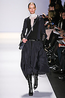 Frida Gustavsson walks the runway in an out by Max Azria, for the BCBGMAXAZRIA Fall 2011 fashion show, during Mercedes Benz Fashion Week.