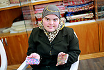 Iman al-Tanani, a 28-year-old a Palestinian woman with Down syndrome works on embroidery in Gaza city on Feb. 16, 2017. al-Tanani got work from United Nations Relief and Works Agency (UNRWA) on handmade, moreover she playing basketball and dance Dabka. Photo by kholoud Lafi