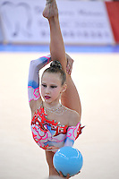 Elena Bolotina of Belarus (junior) performs with clubs at 2010 Holon Grand Prix at Holon, Israel on September 4, 2010.  (Photo by Tom Theobald).