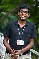 "Akilan Vijayarangam ..22 year old Akilan Vijayarangam is from Chennai. He works under the first level support team and MOC (Management Operational Centre) wherein his work involves monitoring engineering screen and assigning tickets to relevant groups. Akilan works an average of 9 hours a day and plays badminton and Table Tennis with his bosses during spare time. He also represents his office Table Tennis team for various competitions.  ""I am lucky I get to play with the big bosses, I get to have personal interaction with them - and they constantly encourage me not only for my professional development but also on the sports front,"" says Akilan. ""They are very simple people, and do not have a concept of hierarchy"" he laughingly adds...Akilan couldn't afford to pay his engineering college fees while he was studying Computer Science, but managed to get scholarships and complete his studies. "" I won many accolades for my college for various sports events I participated, I do the same here... sports is very important for me, and MindTree appreciates it, and helps me realise my dreams, not just by sitting behind the computer but on sports arenas too."" ..KPN company, Getronics, has off shored multiple business units to the Indian company, Mind Tree in Bangalore, the 'Silicon Valley of India', in the state of Karnataka, India. .Photo by Suzanne Lee for Hollandse Hoogte."