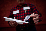 Richard Olsen, a supporter of GOP presidential candidate Newt Gingrich hands out stickers before a campaign event in Reno, Nevada, February 1, 2012.