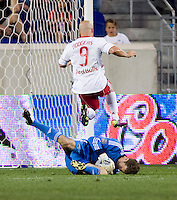 William Hesmer (1) of the Columbus Crew takes control of the ball in front of Luke Rodgers (9) of the New York Red Bulls during the game at Red Bull Arena in Harrison, NJ.  The New York Red Bulls tied the Columbus Crew, 1-1.