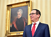United States Secretary of the Treasury Steven Munchin listens as US President Donald Trump delivers remarks during his swearing-in ceremony at the White House in Washington, D.C. on February 13, 2017. Mnuchin was confirmed by the Senate 54-47 earlier today. <br /> Credit: Kevin Dietsch / Pool via CNP