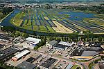 Nederland, Noord-Holland, Broek op Langedijk, 14-07-2008; Gemeente Langedijk; zicht op het bedrijventerrein Zandhorst (Broekhornpolder), aantasting van het landschap van de Polder Heerhugowaard; op het tweede plan natuurgebied Oosterdel, ingeklemd tussen de bebouwing, laatste restantje ongerepte natuur, in beheer bij Staatsbosbeheer; het 'duizend eilandenrijk' , voormalige veengronden, is ontstaan door ontwatering / afgraven van veen en maakt deel uit van de Provinciale Ecologische Hoofdstructuur (EHS); verrommeling, verpaupering van het landschap; bedrijvenloods, doos, dozen, bedrijfshal. .luchtfoto (toeslag); aerial photo (additional fee required); .foto Siebe Swart / photo Siebe Swart