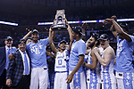 The North Carolina Tar Heels raise the South region trophy after defeating the Kentucky Wildcats 75-73 during the 2017 NCAA Men's Basketball Tournament South Regional Elite 8 at FedExForum in Memphis, TN on Friday March 24, 2017. Photo by Michael Reaves | Staff