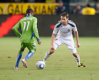 CARSON, CA – NOVEMBER 7:  Seattle Sounders midfielder Steve Zakuani (11) and LA Galaxy defender Todd Dunivant (2) during a soccer match at the Home Depot Center, November 7, 2010 in Carson, California. Final score LA Galaxy 2, Seattle Sounders 1.