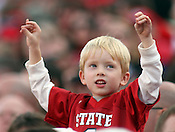 A young State fan cheers on the Wolfpack. NC State defeated Central Michigan 38-24 on Saturday, October 8, 2011 at Carter-Finley Stadium in Raleigh. Photo by Al Drago.