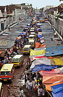 Indonesia. Palembang, South Sumatra.  Indonesia?s ancient oil capital on the Musi River.  Muddy street of market stalls.