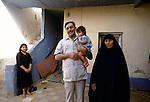 Marsh Arabs. Southern Iraq. Circa 1985. Marsh Arab man  wife and children Baghdad.