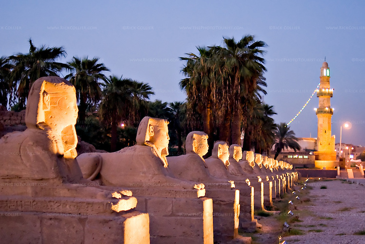 """Luxor, Egypt -- Sphinxes line both sides of the road approaching Luxor Temple.  The road originally extended all the way between Karnak and Luxor temples.  (Today, the road ends at stairs to a mosque, the minaret of which is visible at the """"end"""" of the road.) © Rick Collier / RickCollier.com"""