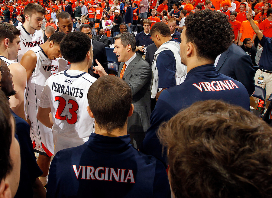 Virginia head coach Tony Bennett talks with his team before the start of the game against Notre Dame Saturday, February 22, 2014,  in Charlottesville, VA. Virginia won 70-49.