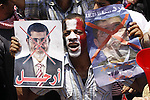 Protesters opposing Egyptian President Mohamed Mursi holds a sign during a protest at Tahrir square in Cairo June 30, 2013. Mass demonstrations across Egypt on Sunday may determine its future, two and half years after people power toppled a dictator they called Pharaoh and ushered in a democracy crippled by bitter divisions. Photo by Ahmed Asad