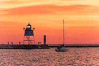 Sunset over Grand Marais lighthouse on Lake Superior.