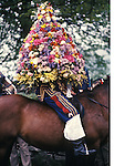 Castleton Garland Day Castleton Derbyshire UK May 29th. Oak Apple Day King covered with beehive of flowers thast will be hoisted up and placed on the church tower.