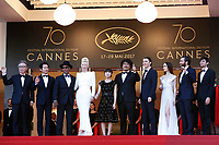 """(L-R) Byung Heebong, Steven Yeun, Giancarlo Esposito, Tilda Swinton Ahn Seo-Hyun, Bong Joon-Ho, Paul Dano, Lily Collins, Jake Gyllenhaal and Devon Bostic at the """"Okja"""" premiere during the 70th Cannes Film Festival at the Palais des Festivals on May 19, 2017 in Cannes, France. (c) John Rasimus /MediaPunch ***FRANCE, SWEDEN, NORWAY, DENARK, FINLAND, USA, CZECH REPUBLIC, SOUTH AMERICA ONLY***"""
