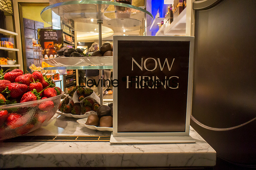 A Godiva chocolate store on Fifth Avenue in New York advertises that it is hiring workers with a sign in the window, seen on Tuesday, October 1, 2013.  (© Richard B. Levine)