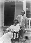 JOHN AND ODESSA JOHNSON, AUGUST 1918. When Odessa Price married John Johnson in 1918, she was 27 and he was 39. This is probably their wedding portrait. The Johnsons were married for 34 years and died within months of each other in 1953. John Johnson must have had assistance in triggering the shutter of his bulky view camera, but his own portrait shows the same combination of careful composition and relaxed subjects seen throughout his photographs. John graduated from Lincoln High School in 1899, where he was a member of the track team. He briefly attended the University of Nebraska, where he played football. He was a laborer and janitor at the U.S. post office and courthouse from 1904 to 1917, and again through the 1930s, but also worked as a drayman and a teamster. John compiled an extensive listing of the African American residents of Lincoln and their occupations for Negro History Week in 1938, mentioning five individuals who worked at portrait studios as photographer's assistants. Under the heading photographer, he listed only &quot;John Johnson.&quot;<br /> <br /> Photographs taken on black and white glass negatives by African American photographer(s) John Johnson and Earl McWilliams from 1910 to 1925 in Lincoln, Nebraska. Douglas Keister has 280 5x7 glass negatives taken by these photographers. Larger scans available on request.