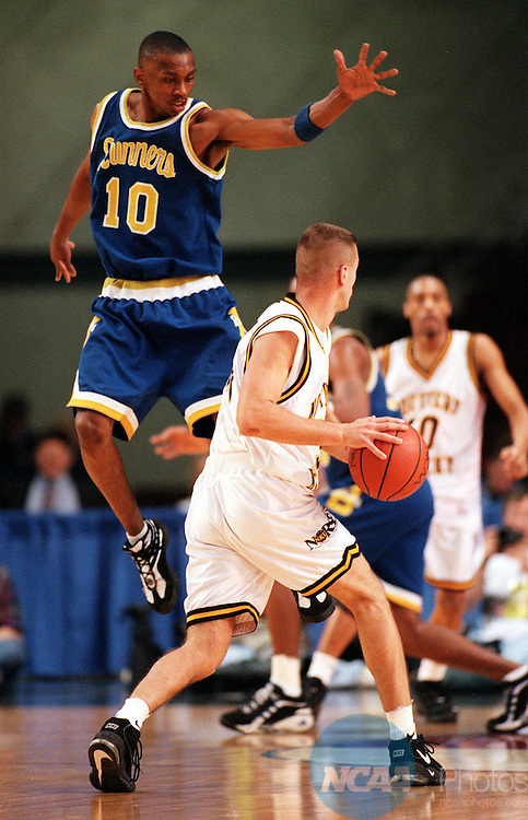 22 Mar 1997: California State Bakersfield guard Charles Woolfolk (10) defends a pass from guard Paul Cluxton (33) of Northern Kentucky during the Men's Division 2 Basketball Championships at the Commonwealth Convention Center in Louisville, KY. California State University at Bakersfield defeated Northern Kentucky, 57-56. Chris Hall/NCAA Photos.