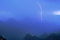 749220235 a summer monsoon storm puts on a lightning show over the canyon seen from the north rim of grand canyon national park in northern arizona