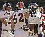 Denver Broncos quarterback Brian Griese (14) congratulates Broncos running back Olandis Gary (22) on touchdown on Sunday, September 15, 2002, in San Francisco, California. The Broncos defeated the 49ers 24-14. .