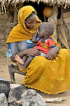 A mother and her daughter in Geles, an Arab village in Darfur where ACT-Caritas has provided wells and a variety of other services. While the ACT-Caritas Darfur Emergency Response Operation is focused primarily on responding to the needs of Darfur's internally displaced people, it also is helping Arab villages, many of them host communities, as a contribution toward reconciliation and peace.