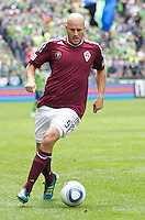Colorado Rapids forward Conor Casey dribbles teh ball during play against the Seattle Sounders FC at CenturyLink Field in Seattle Saturday July 17, 2011. The Sounders won the game 4-3.