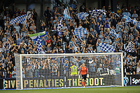 KANSAS CITY, KS - June 1, 2013:<br /> Sporting KC supporters waving flags behind the Impact goal.<br /> Montreal Impact defeated Sporting Kansas City 2-1 at Sporting Park.