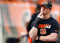 Andy Dalton #14 of the Cincinnati Bengals looks on from the sideline while wearing a cast after leaving the game with a hand injury against the Pittsburgh Steelers during the game at Paul Brown Stadium on December 12, 2015 in Cincinnati, Ohio. (Photo by Jared Wickerham/DKPittsburghSports)