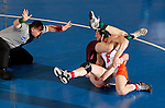 12 MAR 2011: Michael Lybarger of Findlay (in white and orange) wrestles Zach McKendree of Gannon during the Division II Men's Wrestling Championship held at the UNK Health and Sports Center on the University of Nebraska - Kearney campus in Kearney, NE. Lybarger defeated McKendree 3-1 to win the 165-lb national title. Corbey R. Dorsey/ NCAA Photos