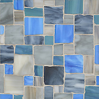 Garden Party, a handmade mosaic shown in Lavastone, Zircon, Tourmaline, and Peacock Topaz Sea Glass&trade;, is part of the Sea Glass&trade; Collection by Sara Baldwin for New Ravenna. <br />