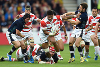 Amanaki Mafi of Japan fends Greig Laidlaw of Scotland. Rugby World Cup Pool B match between Scotland and Japan on September 23, 2015 at Kingsholm Stadium in Gloucester, England. Photo by: Patrick Khachfe / Onside Images