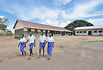 Children in the Southern Sudanese village of Jombo walk home after class from their new school constructed by the United Methodist Committee on Relief (UMCOR). Families here are rebuilding their lives after returning from refuge in Uganda.