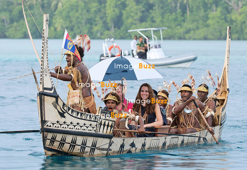 CATHERINE, DUCHESS OF CAMBRIDGE AND PRINCE WILLIAM.travel in a war canoe accompanied by tribesman, to Tavanipupu, where they spent their last night of their tour of the Solomon Islands_17/09/2012